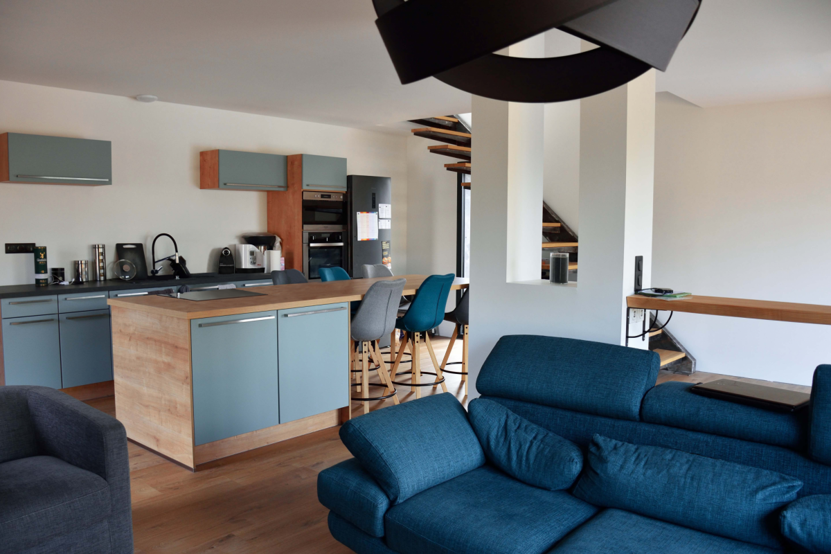 livingroom plus kitchen in a design house in Occitanie